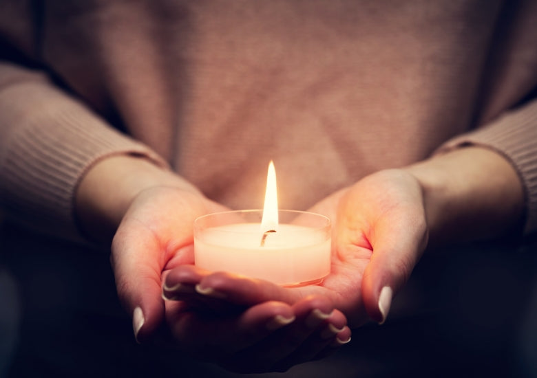 woman holding candle in her hand (natural candlelight)