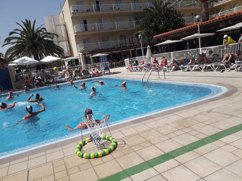 Ryan Bomzer playing water polo in the swimming pool in menorca spain
