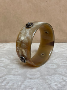 Horn bangle with vintage buttons