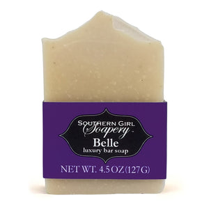 4.5 ounce Southern Girl Soapery Belle Bar Soap with pale purple color,  decorative top, and purple label