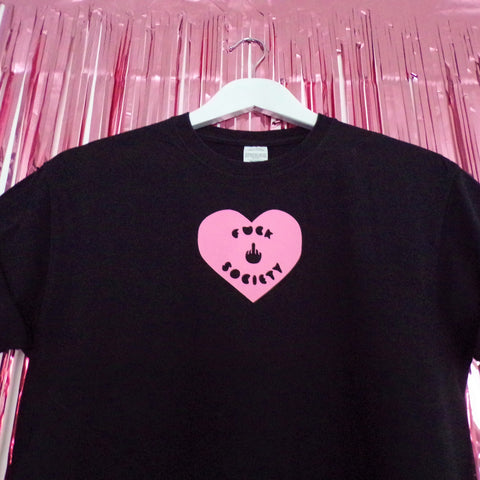 Fuck Society pink heart printed on a black t-shirt by Pink Clouding with swearing finger close up