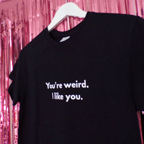 You're weird I like you White font printed on Black t-shirt by Pink Clouding Close Up