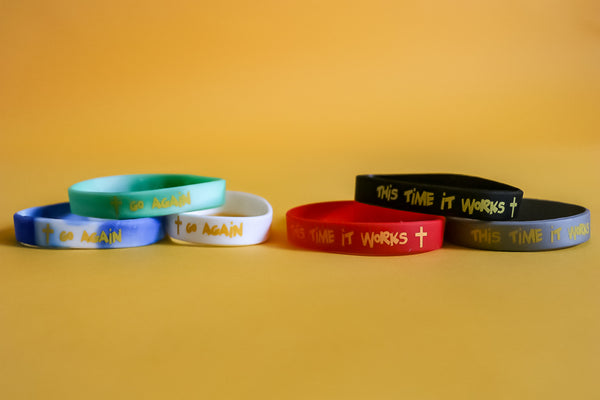"""Go Again. This Time It Works"" Wristbands"