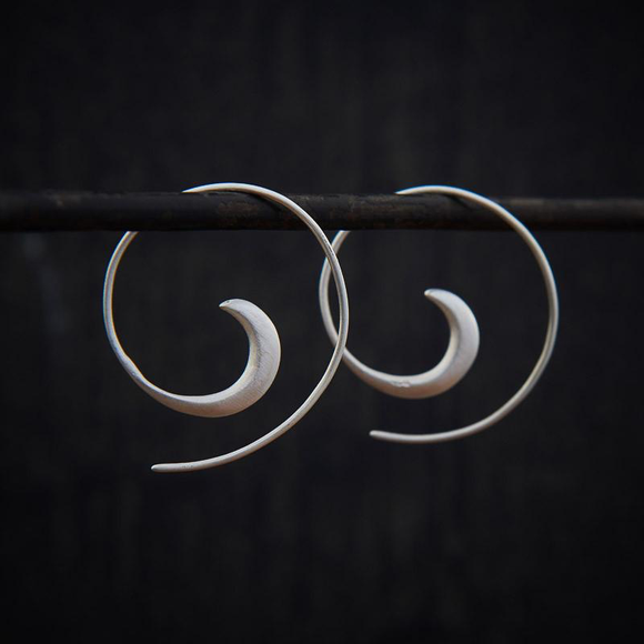 Silver hoop earrings by Annie Mundy