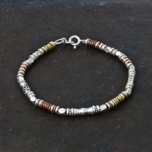 Silver, copper and brass bracelet by Annie Munday