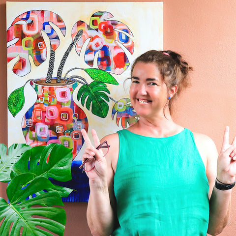 "Photo of RIMAAD artist Rachel Ireland Meyers with the final completed painting ""The Odd Pot"""