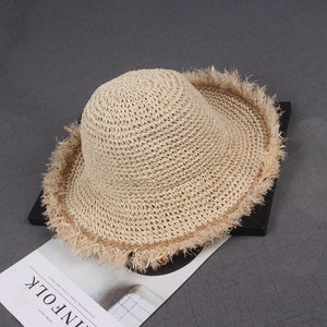Frayed straw hat