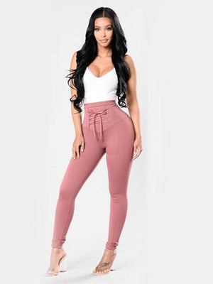 Cinched-waist skinny pants with tie around the waist