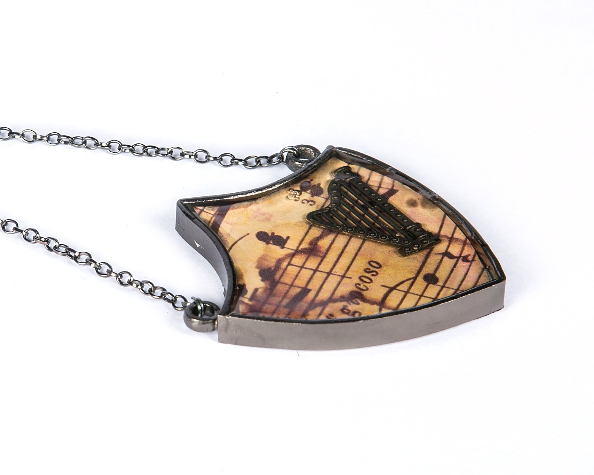 Shield neckpiece with musical instrument harp on musical notes