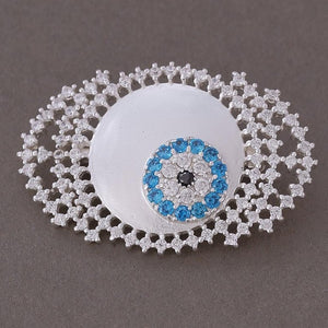 White zircon studded evil eye brooch