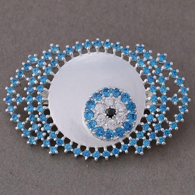 Blue zircon studded evil eye brooch