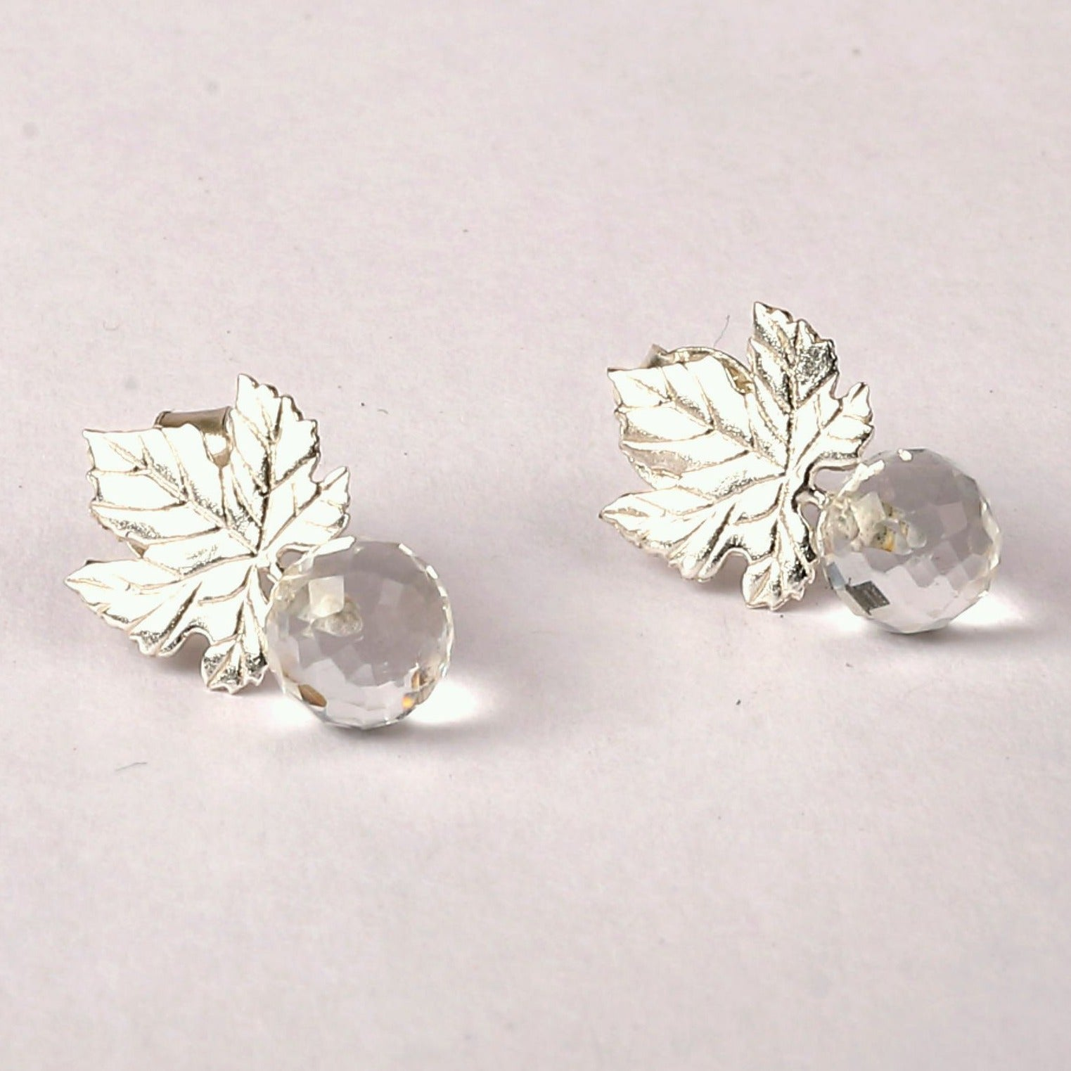 Silver ivy leaf and faceted crystal quartz ball earrings