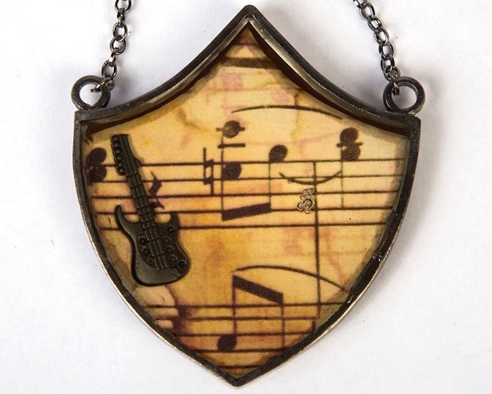 Copper with vintage finish musical guitar neckpiece