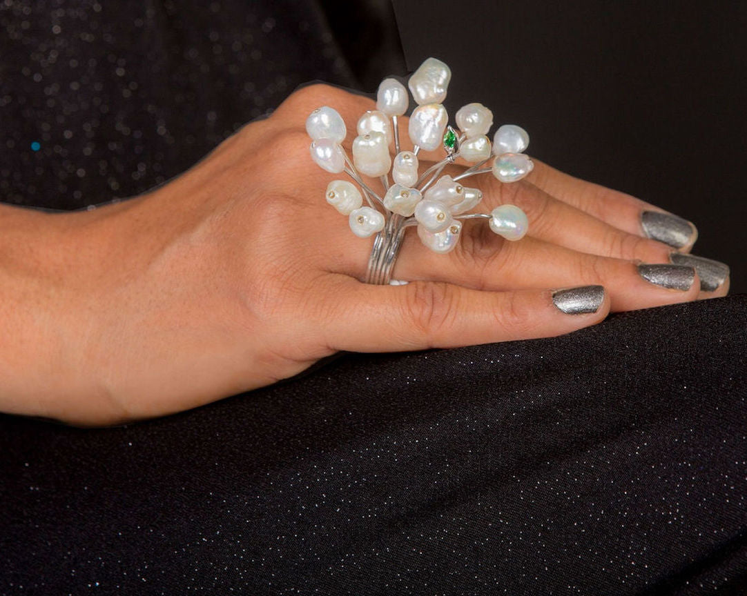 Finger adorned with fresh water baroque pearl ring