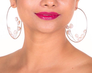 model with baroque bud ear hoops