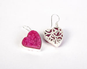 Back view of pink heart shaped earrings