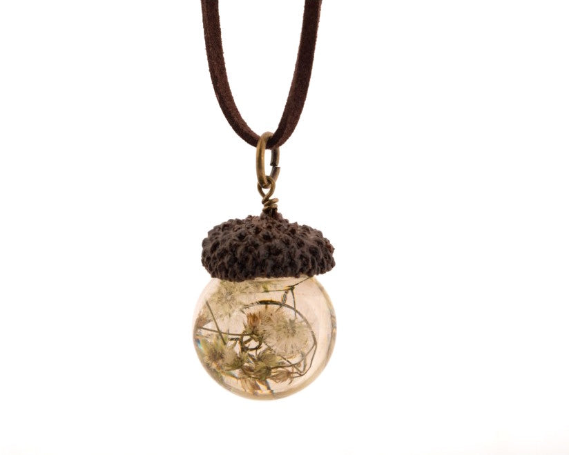 Acorn shaped pendant strung in a leather cord