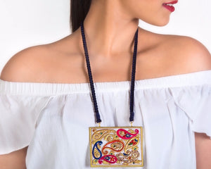 A model wearing Marble pendent with Kundan beads and Meenakari work