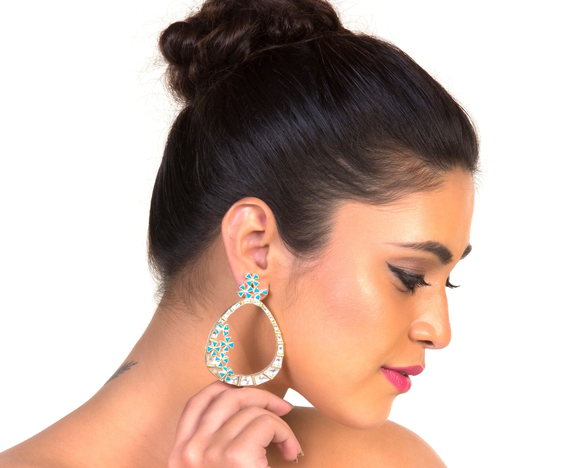 Model with kundan hoop style earrings