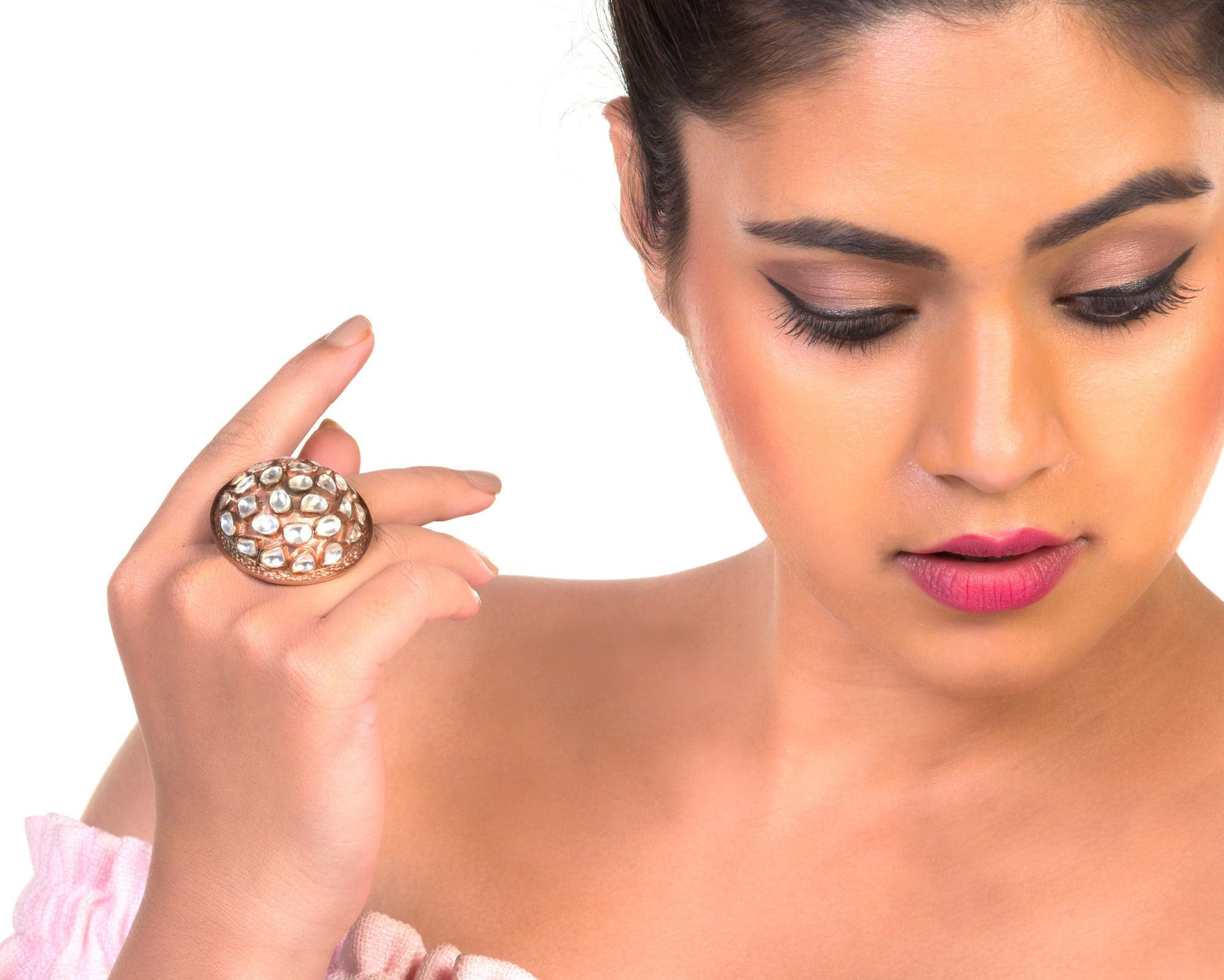 model with shiny dome finger ring
