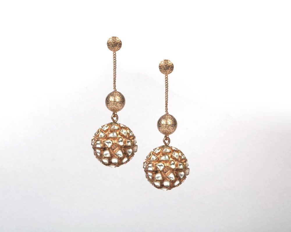 Copper with rose gold plating with silver kundan work earrings