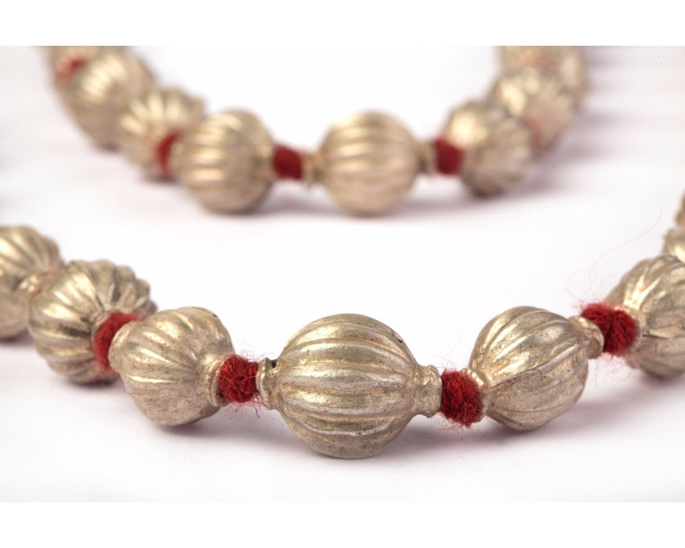 Antique silver beads in red thread necpiece
