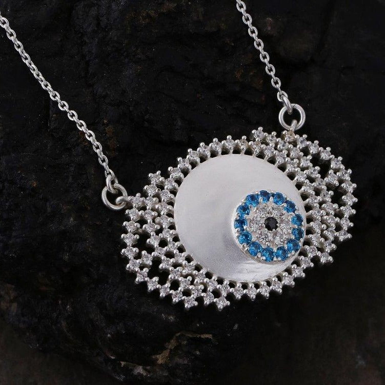Evil eye neckpiece in white