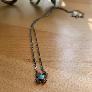Dainty turquoise and. bronze criss cross necklace