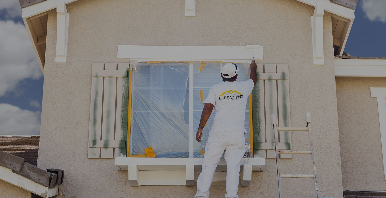 Man painting a home