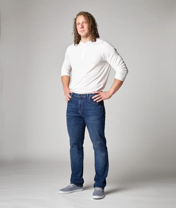 Front view of model wearing Edison Atlas North wash denim