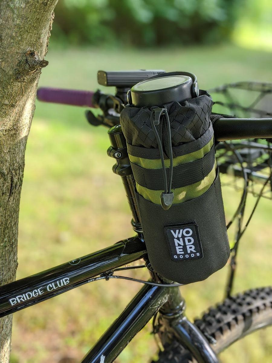 Olive stem bag with Hydro Flask® showing  Wonder Goods patch.
