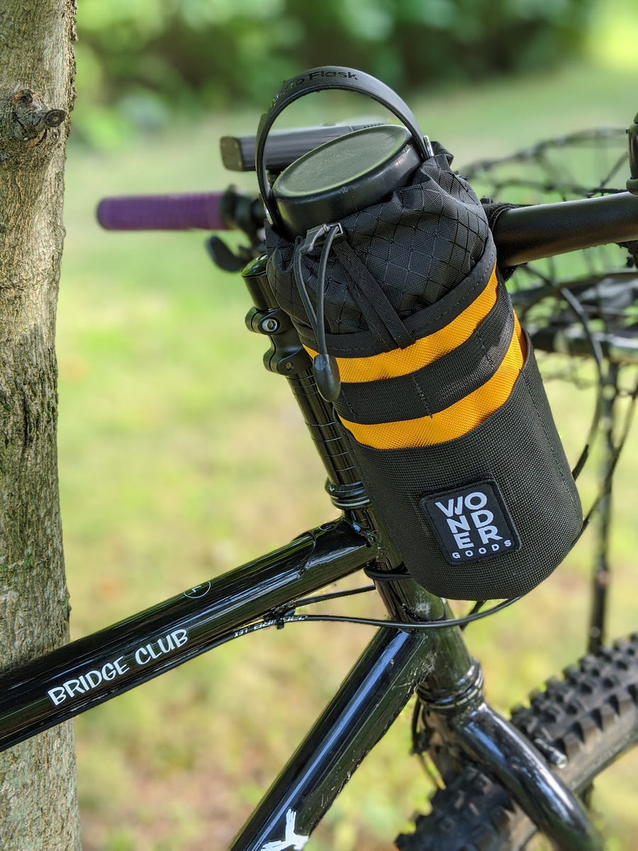 Mango snack pack stem bag mounted to bike with a Hydro Flask®.