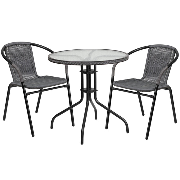 28'' Round Glass Metal Table with Rattan Edging and 2 Rattan Stack Chairs