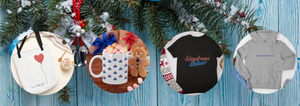 Willow and Poppy shop with blue woodgrain background, pine boughs and snow. Gift items include the Have a Little Faith Tote Bag, the curling rock mug, Daydream Believer tshirt and the trendsetter hoodie. All available in our shop! Happy Holidays!