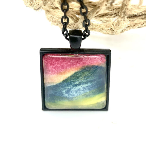 Landscape in Yellows, Blues, Pinks Watercolor Necklace in a Black Setting