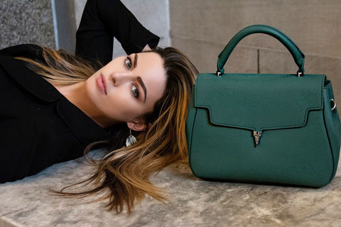 angela Mariah founder with structured top handle bag