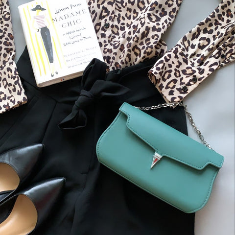 chic flatlay with green bag