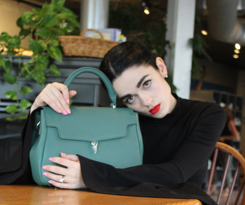 slow fashion movement, green handbag