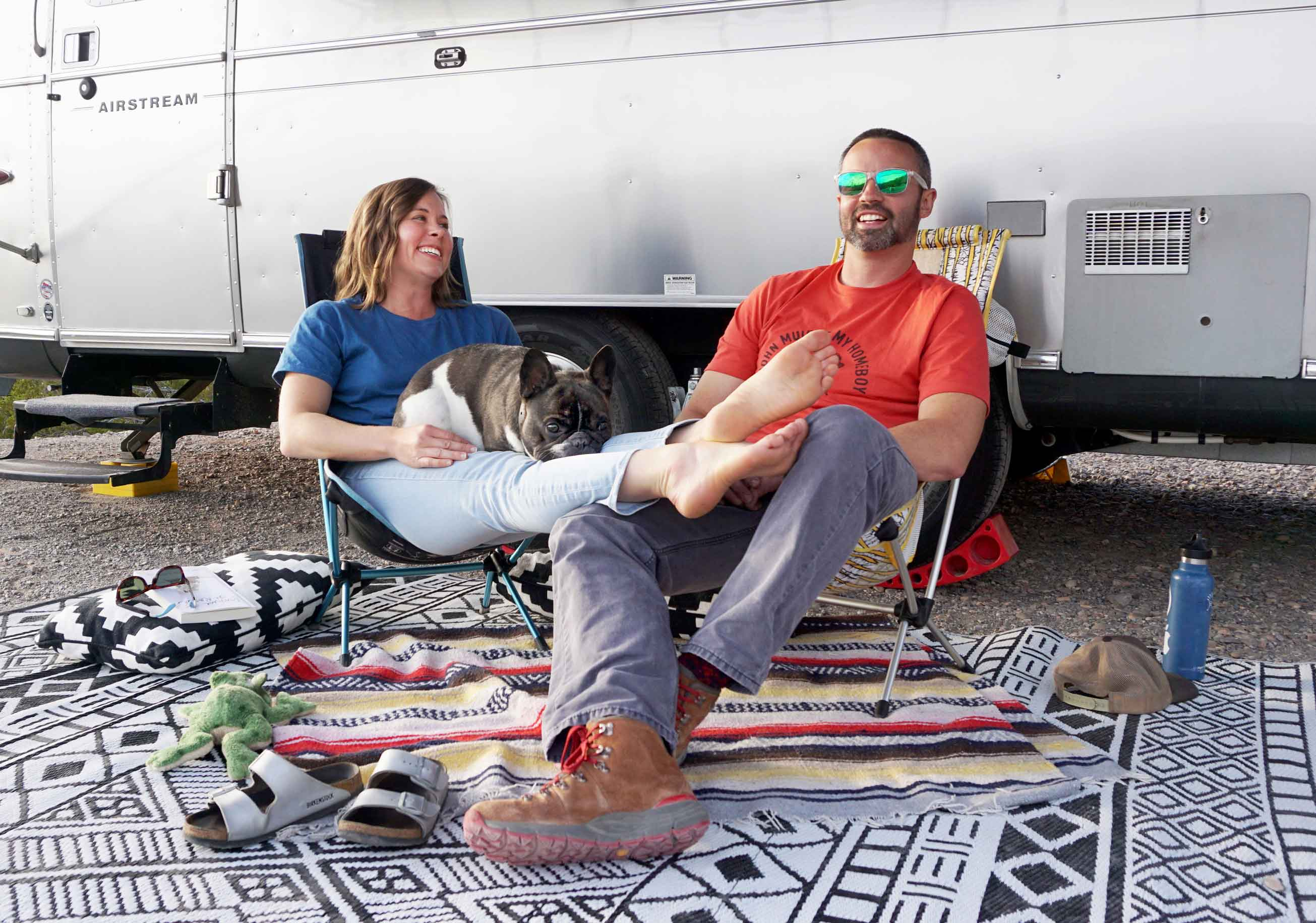 Kate Smith Company owners and their dog Frank in front of their Airstream
