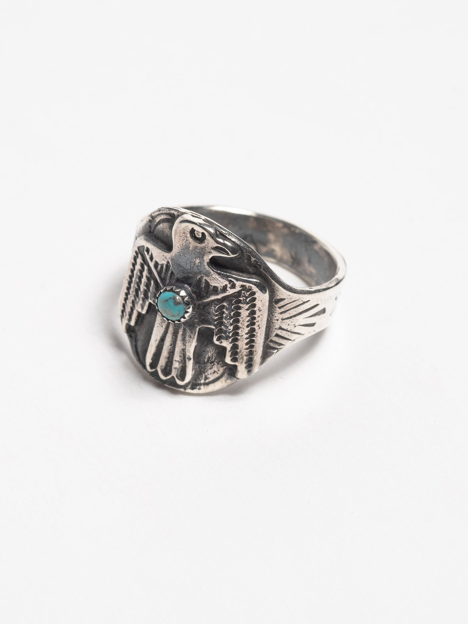 vintage-sterling-silver-navajo-thunderbird-ring-with-stamped-arrow-design