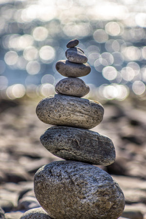 Stacked stones on a beach; Photo by Deniz Altindas on Unsplash