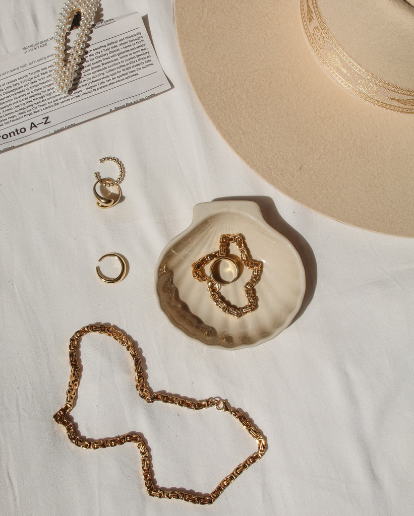 flatlay featuring the bare sea 18K gold plated sterling silver adriana necklace