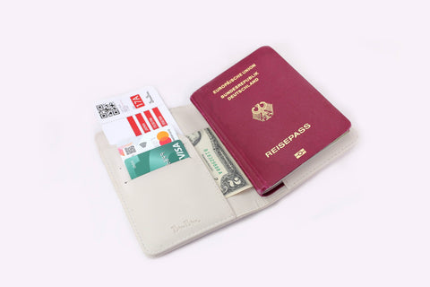 Why You Should Have A Passport Holder Or Passport Case? Pros and Cons