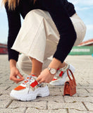 Sneakers pitonata con dettagli orange