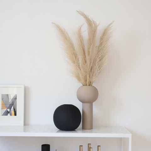 Minimalist Pillar Vase and Ball Vase from COOEE Design Styled Atop a Shelf | Batten Home