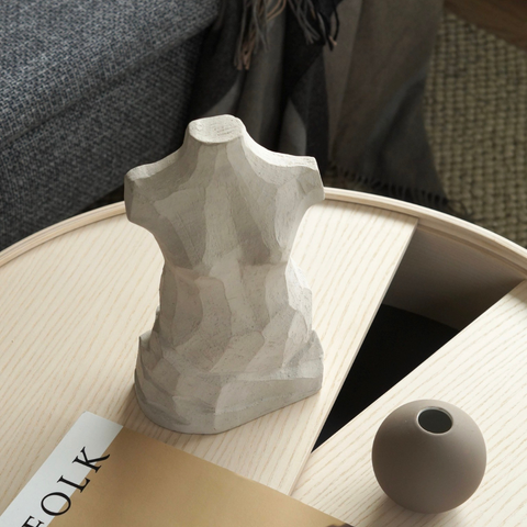 Minimalist coffee table styling featuring COOEE Design ball vase and sculptures