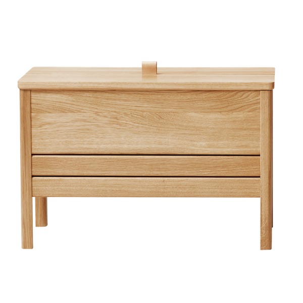 The A Line Storage Bench by Form and Refine is an updated and minimal storage bench with clean lines and solid wood construction, perfect for entryways and bedrooms.