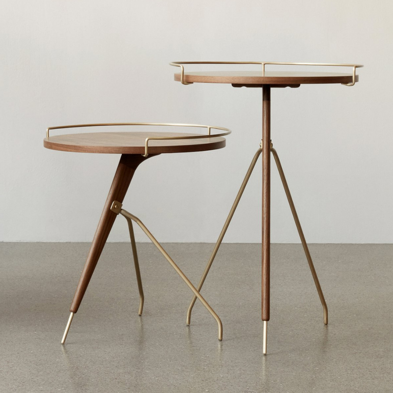 The Umanoff Side Table is a beautiful rendition of the original design first created and distributed in the 1950s. Today's table still features the classic combination of walnut and brass on a tripod of legs, perfect for small or large spaces.