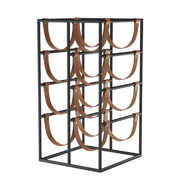 The Umanoff Wine Rack by MENU is a stunning ode to mid-century modern design, with all the classic textiles found in any home. We love the combination of leather and black powder coated steel, which creates a luxe yet industrial look.   Style this piece atop a credenza or in the kitchen, it's sleek and welcoming design will look stunning when filled with your favorite bottles of wine, and equally beautiful when a couple disappear.
