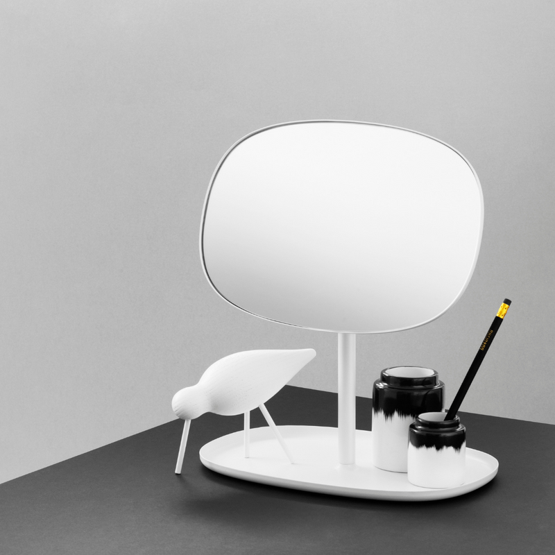 The Flip Mirror by Normann Copenhagen was created in collaboration with Javier Moreno Studio as a beautifully simplistic table mirror that can be rotated 360 degrees. We appreciate the organic shape the mirror takes on, which is amplified by the easy flow of movement expressed when turning the mirror as needed.
